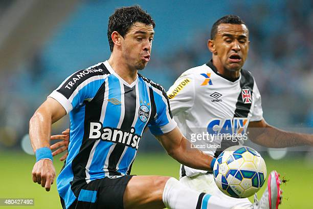 Giuliano of Gremio battles for the ball against Serginho of Vasco during the match between Gremio and Vasco as part of Brasileirao Series A 2015 at...