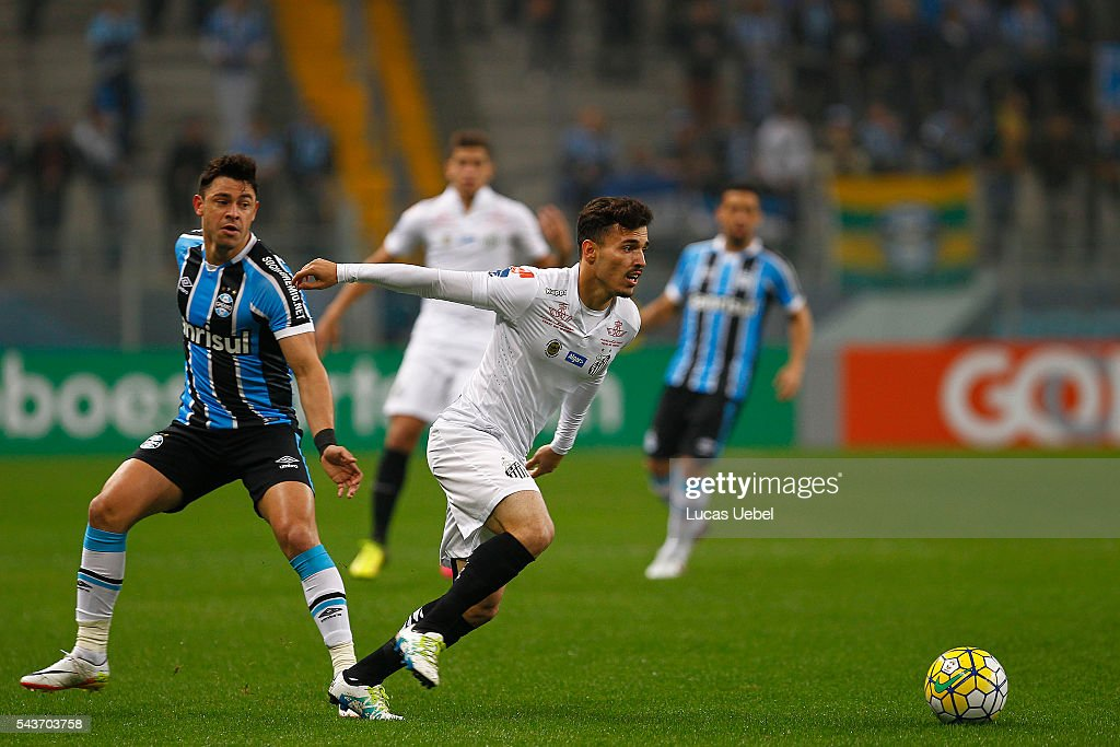 Giuliano of Gremio battles for the ball against Zeca of Santos during the match Gremio v Santos as part of Brasileirao Series A 2016, at Arena do Gremio on June 03, 2015 in Porto Alegre, Brazil.