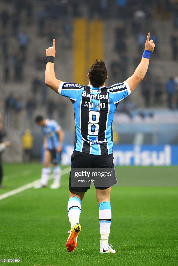 Giuliano of Gremio celebrates his team's first goal during the match Gremio v Santos as part of Brasileirao Series A 2016, at Arena do Gremio on June 03, 2015 in Porto Alegre, Brazil.
