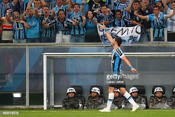 Giuliano of Gremio celebrates their first goal during the match Gremio v Internaciona as part of Brasileirao Series A 2015 at Arena do Gremio on...