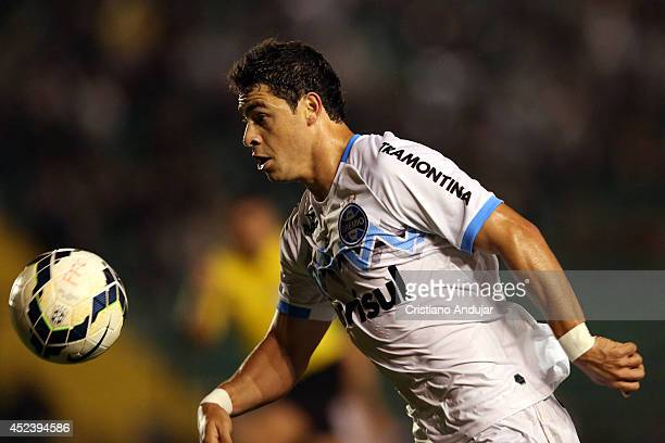 Giuliano of Gremio in action during a match between Figueirense and Gremio as part of Campeonato Brasileiro 2014 at Orlando Scarpelli Stadium on July...