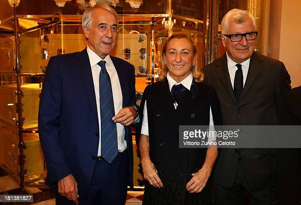 Giuliano Pisapia Miuccia Prada and Patrizio Bertelli attend the Prada cocktail party as a part of Milan Fashion Week Womenswear Spring/Summer 2014 on...