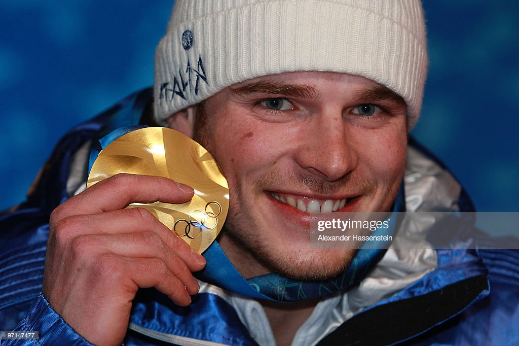 <a gi-track='captionPersonalityLinkClicked' href=/galleries/search?phrase=Giuliano+Razzoli&family=editorial&specificpeople=4835259 ng-click='$event.stopPropagation()'>Giuliano Razzoli</a> of Italy celebrates the gold medal during the medal ceremony for the Alpine Men's Slalom on day 16 of the Vancouver 2010 Winter Olympics at Whistler Medals Plaza on February 27, 2010 in Whistler, Canada.