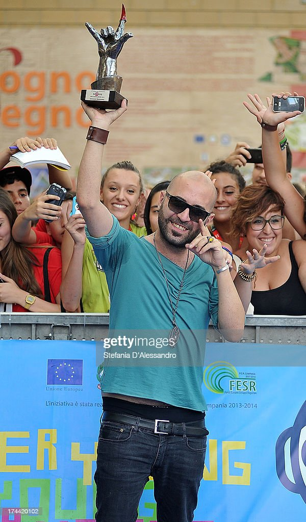 Giuliano Sangiorgi of Negramaro poses with the Giffoni Award at the 2013 Giffoni Film Festival blue carpet on July 25, 2013 in Giffoni Valle Piana, Italy.