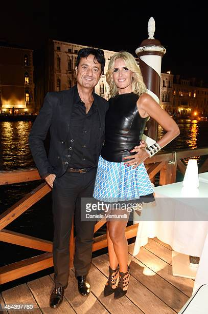 Giulio Base and Tiziana Rocca attend Tiziana Rocca Birthday Party during the 71st Venice Film Festival at Centurion Palace Hotel on August 30 2014 in...