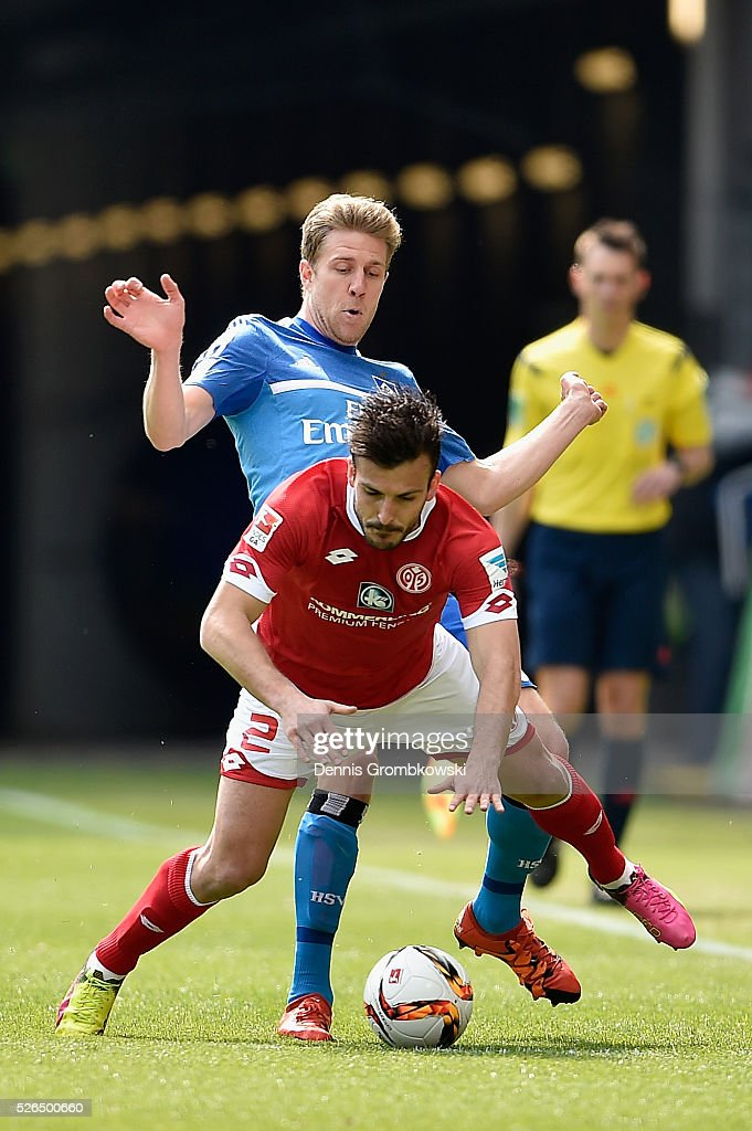 Giulio Donati of 1. FSV Mainz 05 is challenged by Sven Schipplock of Hamburger SV during the Bundesliga match between 1. FSV Mainz 05 and Hamburger SV at Coface Arena on April 30, 2016 in Mainz, Germany.