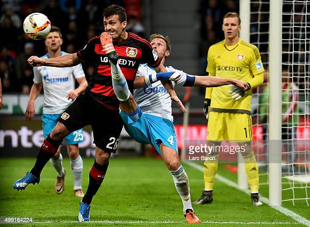 Giulio Donati of Leverkusen challenges Benedikt Hoewedes of Schalke during the Bundesliga match between Bayer Leverkusen and FC Schalke 04 at...