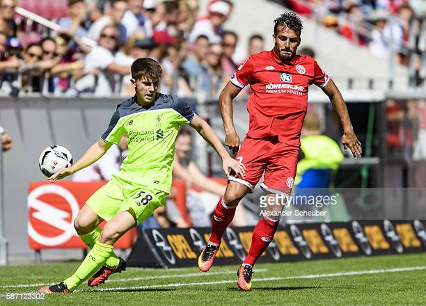Giulio Donati of Mainz 05 challenges Ben Woodburn of Liverpool during the friendly match between 1 FSV Mainz 05 and Liverpool FC at Opel Arena on...