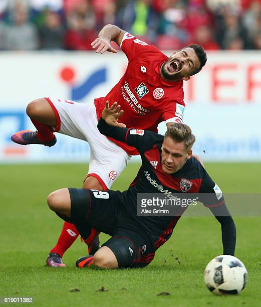 Giulio Donati of Mainz is tackled by Max Christiansen of Ingolstadt during the Bundesliga match between 1 FSV Mainz 05 and FC Ingolstadt 04 at Opel...