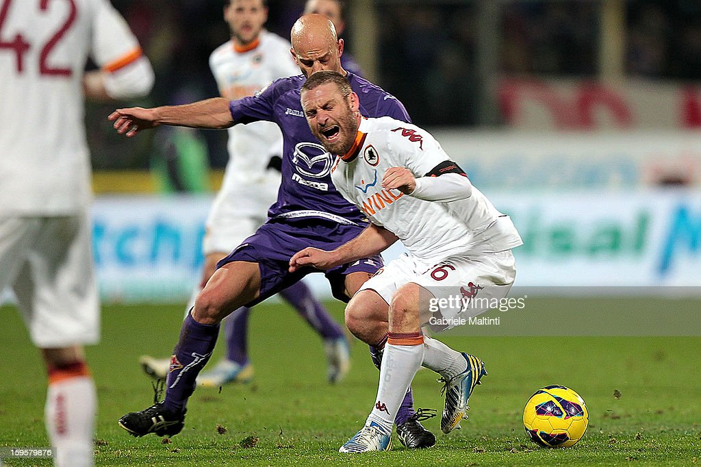 Giulio Migliaccio of ACF Fiorentina fights for the ball with Daniele De Rossi of AS Roma during the TIM cup match between ACF Fiorentina and AS Roma at Artemio Franchi on January 16, 2013 in Florence, Italy.