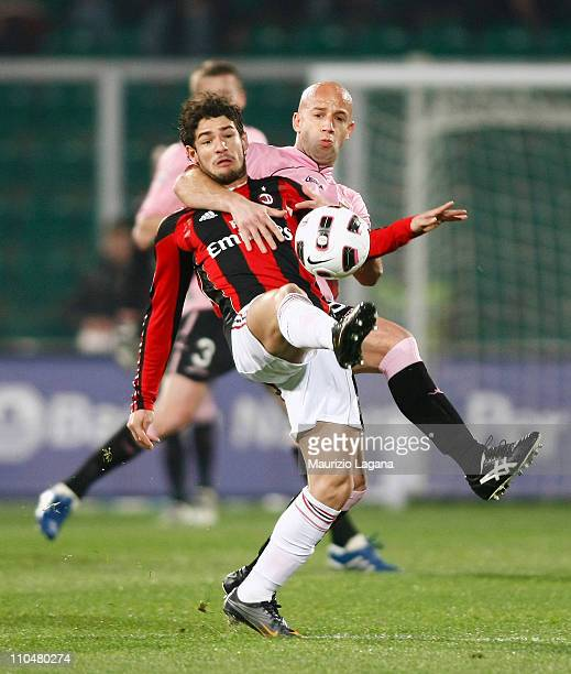 Giulio Migliaccio of Palermo battles for the ball with Alexandre Pato of Milan during the Serie A match between Palermo and AC Milan at Stadio Renzo...