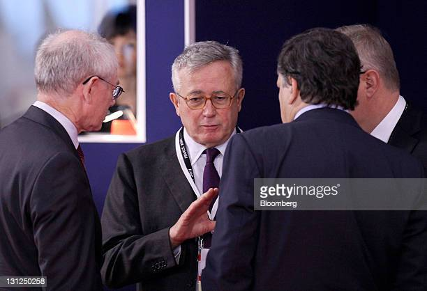 Giulio Tremonti Italy's finance minister second left gestures as he speaks with Herman Van Rompuy president of the European Council left and Jose...