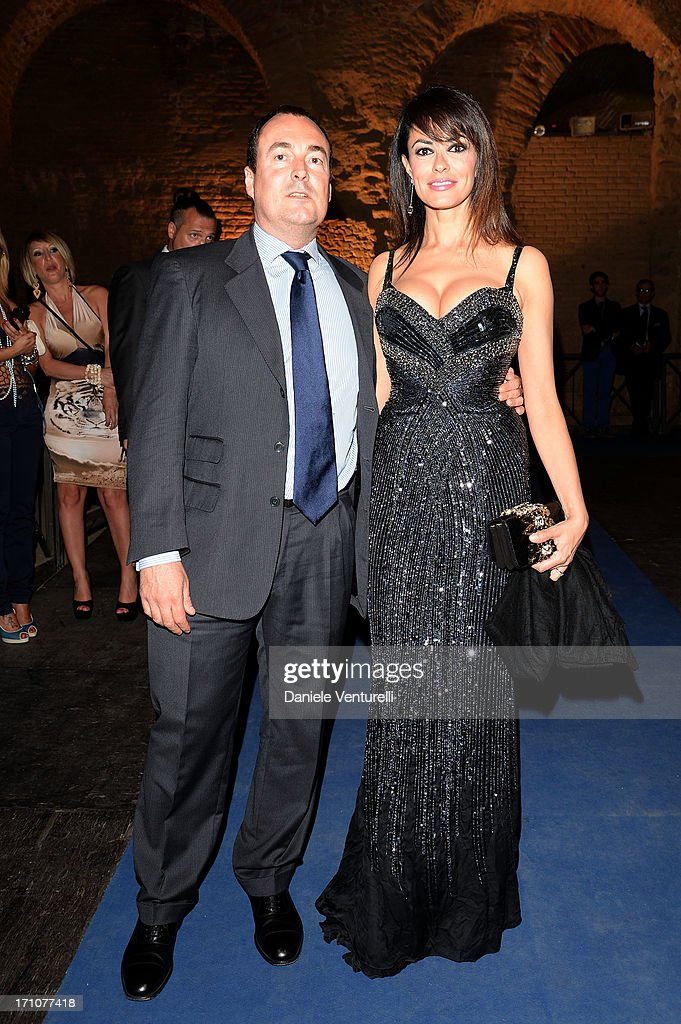 Giulio Violati and <a gi-track='captionPersonalityLinkClicked' href=/galleries/search?phrase=Maria+Grazia+Cucinotta&family=editorial&specificpeople=236018 ng-click='$event.stopPropagation()'>Maria Grazia Cucinotta</a> attend Taormina Filmfest 2013 at Teatro Antico on June 21, 2013 in Taormina, Italy.