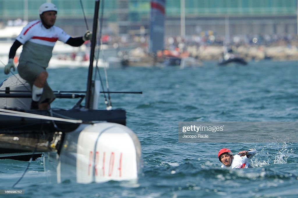 Giuseppe Acquafredda of Luna Rossa of Luna Rossa falls in the water after a collision with EmiratesTeam NZ during the America's Cup World Series Naples on April 19, 2013 in Naples, Italy.