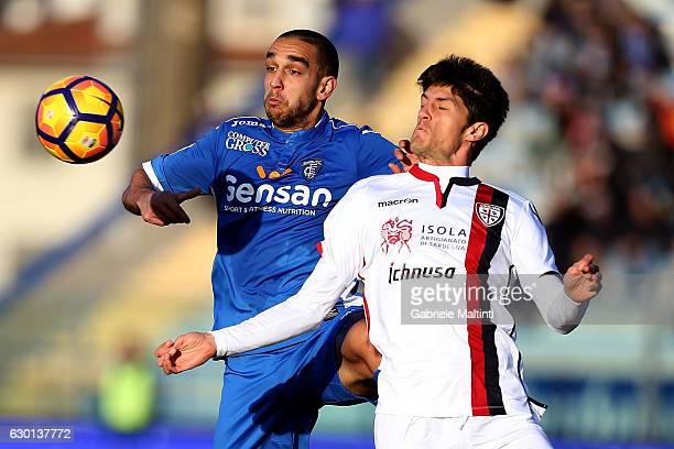 Giuseppe Bellusci of Empoli FC battles for the ball with Federico Melchiorri of Cagliari Calcio during the Serie A match between Empoli FC and...
