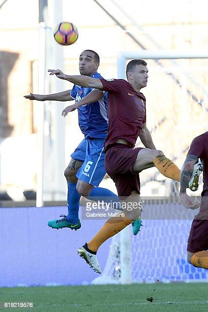 Giuseppe Bellusci of Empoli Fc for the ball with Edin Dzeko of AS Roma during the Serie A match between Empoli FC and AS Roma at Stadio Carlo...