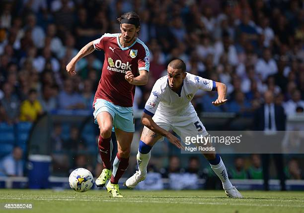 Giuseppe Bellusci of Leeds United challenges George Boyd of Burnley during the Sky Bet Championship match between Leeds United and Burnley at Elland...