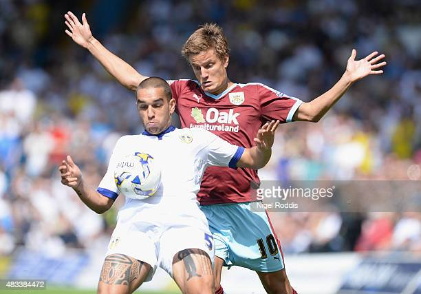 Giuseppe Bellusci of Leeds United challenges Jelle Vossen of Burnley during the Sky Bet Championship match between Leeds United and Burnley at Elland...