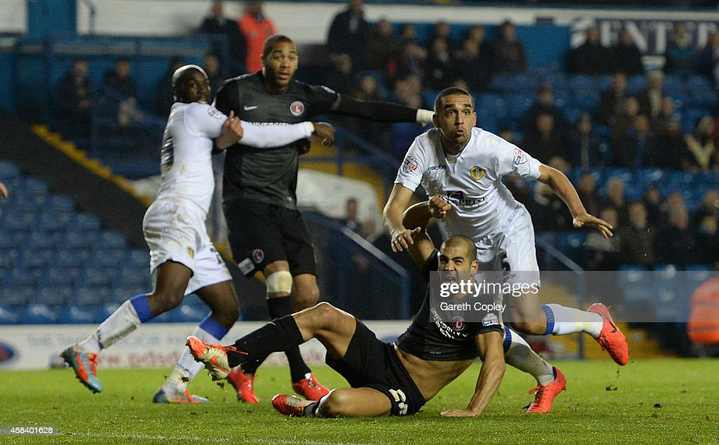 Giuseppe Bellusci of Leeds United pulls down Tal Ben Haim of Charlton Athletic to conceed a penalty during the Sky Bet Championship match between Leeds United and Charlton Athletic at Elland Road on November 4, 2014 in Leeds, England.