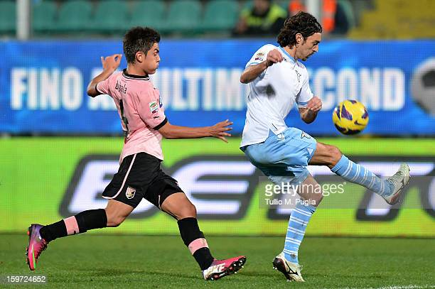 Giuseppe Biava of Lazio holds off the challenge from Paulo Dybala of Palermo during the Serie A match between US Citta di Palermo and SS Lazio at...