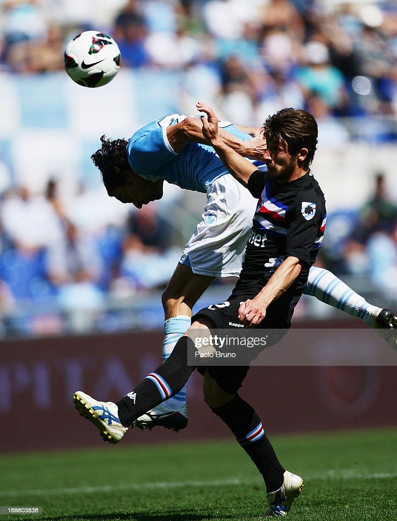 Giuseppe Biava (L) of S.S. Lazio competes for the ball with <a gi-track='captionPersonalityLinkClicked' href=/galleries/search?phrase=Jonathan+Rossini&family=editorial&specificpeople=5780827 ng-click='$event.stopPropagation()'>Jonathan Rossini</a> of UC Sampdoria during the Serie A match between S.S. Lazio and UC Sampdoria at Stadio Olimpico on May 12, 2013 in Rome, Italy.