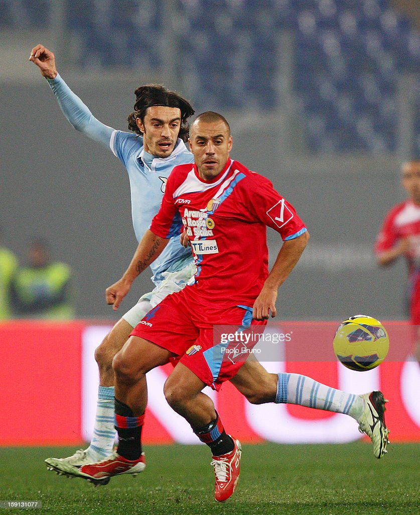 Giuseppe Biava (L) of S.S. Lazio competes for the ball with Sergio Almiron of Calcio Catania during the TIM Cup match between S.S. Lazio and Calcio Catania at Stadio Olimpico on January 8, 2013 in Rome, Italy.