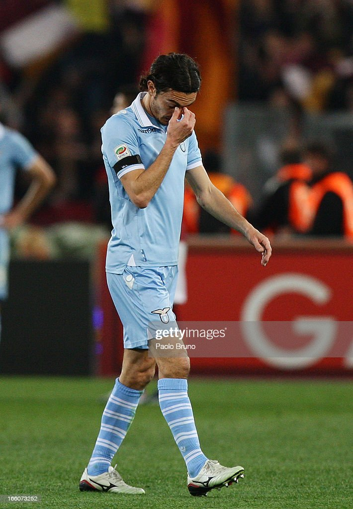 Giuseppe Biava of S.S. Lazio leaves the field after received a red card from referee during the Serie A match between AS Roma and S.S. Lazio at Stadio Olimpico on April 8, 2013 in Rome, Italy.