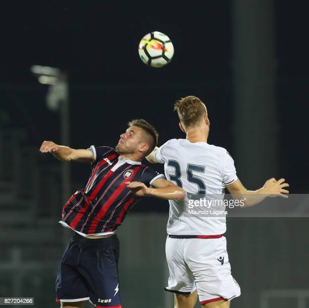 Giuseppe Borello of Crotone competes for the ball in air with Bartosz Salamon of Cagliari during the PreSeason Friendly match between FC Crotone and...