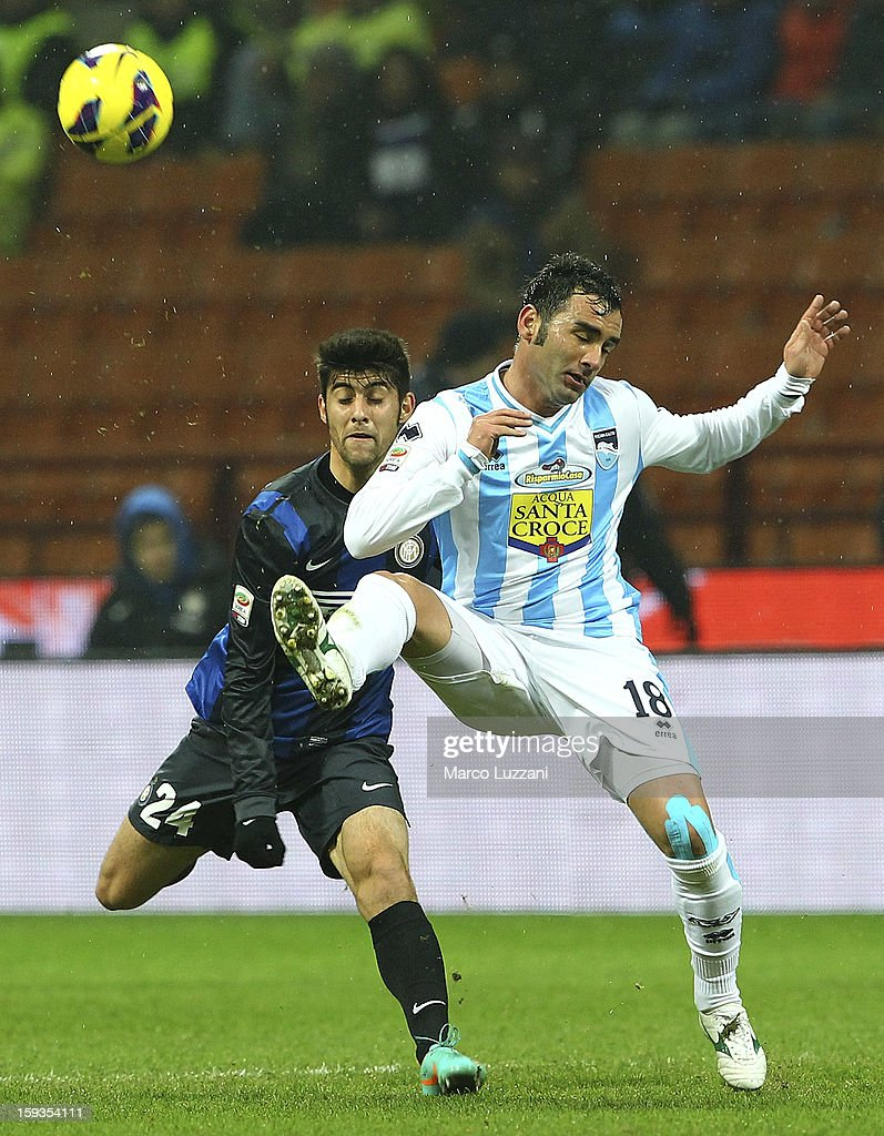 Giuseppe Colucci (R) of Pescara Calcio competes for the ball with Marco Benassi (L) of FC Internazionale Milano during the Serie A match between FC Internazionale Milano and Pescara at San Siro Stadium on January 12, 2013 in Milan, Italy.