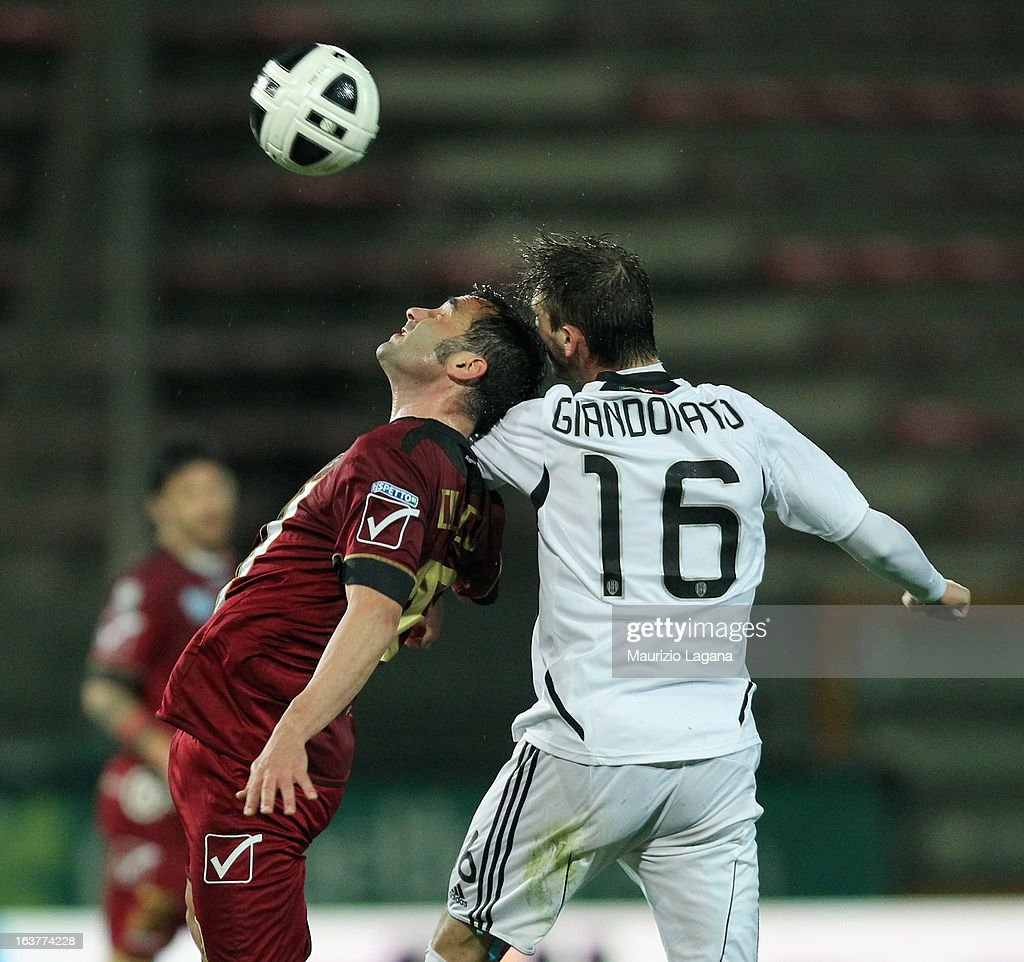 Giuseppe Colucci (L) of Reggina Calcio competes for the ball in air with Manuel Giandonato of AC Cesena during the Serie B match between Reggina Calcio and AC Cesena at Stadio Oreste Granillo on March 15, 2013 in Reggio Calabria, Italy.