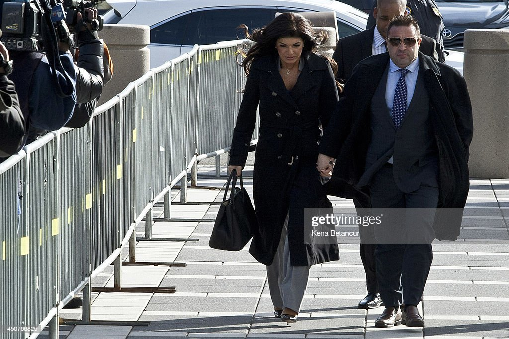 Giuseppe 'Joe' Giudice (R) and wife <a gi-track='captionPersonalityLinkClicked' href=/galleries/search?phrase=Teresa+Giudice&family=editorial&specificpeople=5912953 ng-click='$event.stopPropagation()'>Teresa Giudice</a> arrive to Newark federal court on November 20, 2013 in Newark, New Jersey. The two of the stars of the Bravo television show 'The Real Housewives of New Jersey' are appearing in court to face additional charges of bank fraud and loan application fraud in addition to original charges of defrauding lenders, illegally obtaining mortgages and other loans as well as allegedly hiding assets and income during a bankruptcy case.