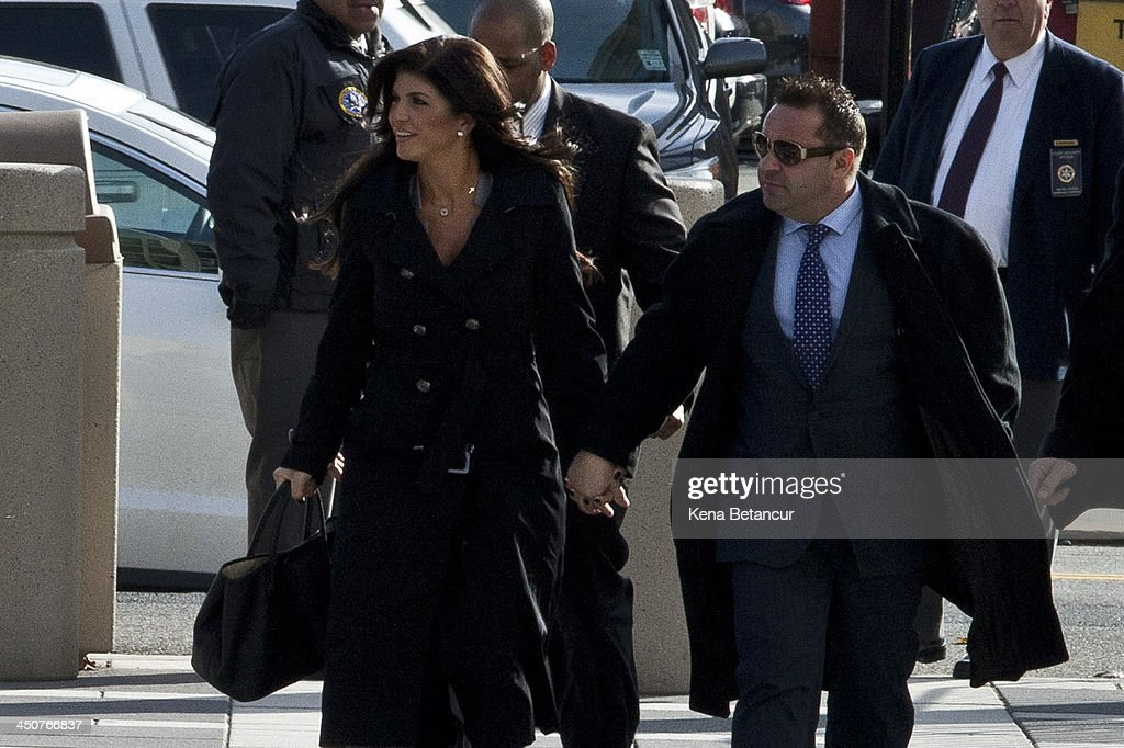 Giuseppe 'Joe' Giudice (R) and wife Teresa Giudice arrive to Newark federal court on November 20, 2013 in Newark, New Jersey. The two of the stars of the Bravo television show 'The Real Housewives of New Jersey' are appearing in court to face additional charges of bank fraud and loan application fraud in addition to original charges of defrauding lenders, illegally obtaining mortgages and other loans as well as allegedly hiding assets and income during a bankruptcy case.