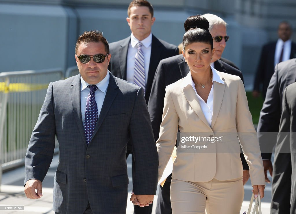 Giuseppe 'Joe' Giudice (L) and wife <a gi-track='captionPersonalityLinkClicked' href=/galleries/search?phrase=Teresa+Giudice&family=editorial&specificpeople=5912953 ng-click='$event.stopPropagation()'>Teresa Giudice</a> leave court after facing charges of defrauding lenders, illegally obtaining mortgages and other loans as well as allegedly hiding assets and income during a bankruptcy case on August 14, 2013 in Newark, United States.