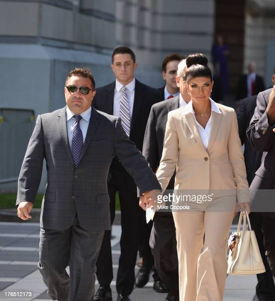 Giuseppe 'Joe' Giudice and wife Teresa Giudice leave court after facing charges of defrauding lenders illegally obtaining mortgages and other loans...