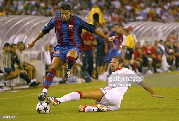 Giuseppe Pancaro of AC Milan steals the ball from Ricardo Quaresma of Barcelona as FC Barcelona defeated AC Milan 20 at RFK Stadium on July 30 2003...