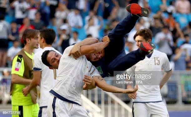 Giuseppe Panico of Italy celebrates with a staff member after scoring the winning penalty during the FIFA U20 World Cup Korea Republic 2017 3rd rank...
