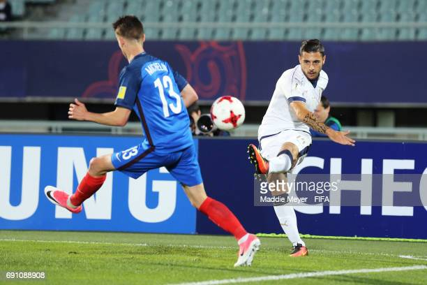 Giuseppe Pezzella of Italy clears the ball past Clement Michelin of France during the FIFA U20 World Cup Korea Republic 2017 Round of 16 match...