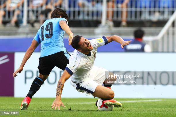 Giuseppe Pezzella of Italy falls over Agustin Canobbio of Uruguay during the FIFA U20 World Cup Korea Republic 2017 3rd rank playoff match between...