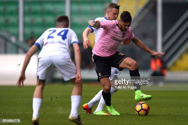 Giuseppe Pezzella of Palermo and Jasmin Kurtic of Atalanta compete for the ball during the Serie A match between US Citta di Palermo and Atalanta BC...