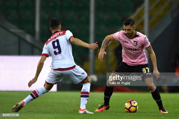 Giuseppe Pezzella of Palermo is challanged by Andrea Nalini of Crotone during the Serie A match between US Citta di Palermo and FC Crotone at Stadio...
