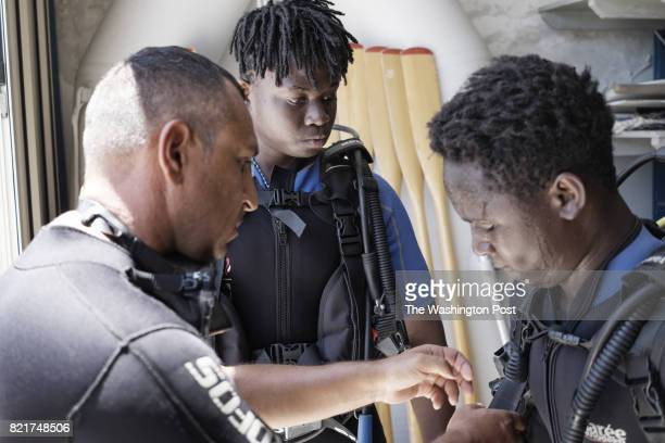 Giuseppe Pinci coordinator of the project 'Friendly Sea' Richard Amegah immigrant from Ghana and Boubacar Barry immigrant from Senegal are portrayed...