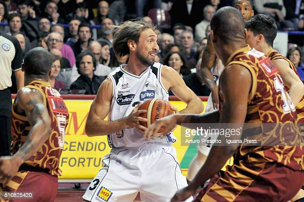 Giuseppe Poeta of Dolomiti Energia competes with Josh Owens and Michele Ruzzier of Umana during the LegaBasket match between Reyer Umana Venezia and...