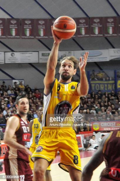 Giuseppe Poeta of Fiat competes with Gediminas Orelik of Umana during the LBA LegaBasket of Serie A match between Reyer Umana Venezia and Auxilium...