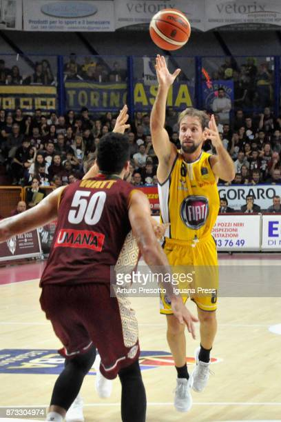 Giuseppe Poeta of Fiat competes with Mitchell Watt of Umana during the LBA LegaBasket of Serie A match between Reyer Umana Venezia and Auxilium Fiat...