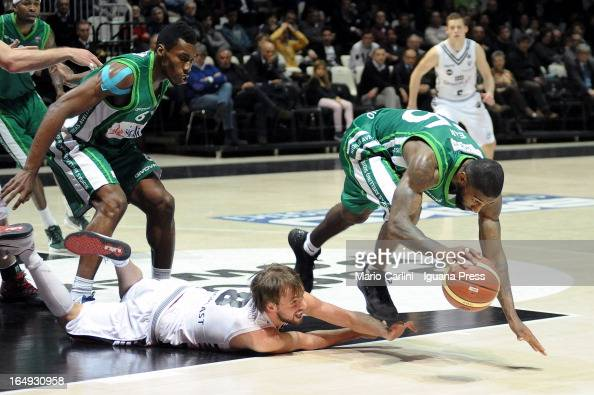 Giuseppe Poeta of Oknoplast competes with Taquan Dean of Sidigas during Legabasket Serie A match between Oknoplast Bologna and Sidigas Avellino at...
