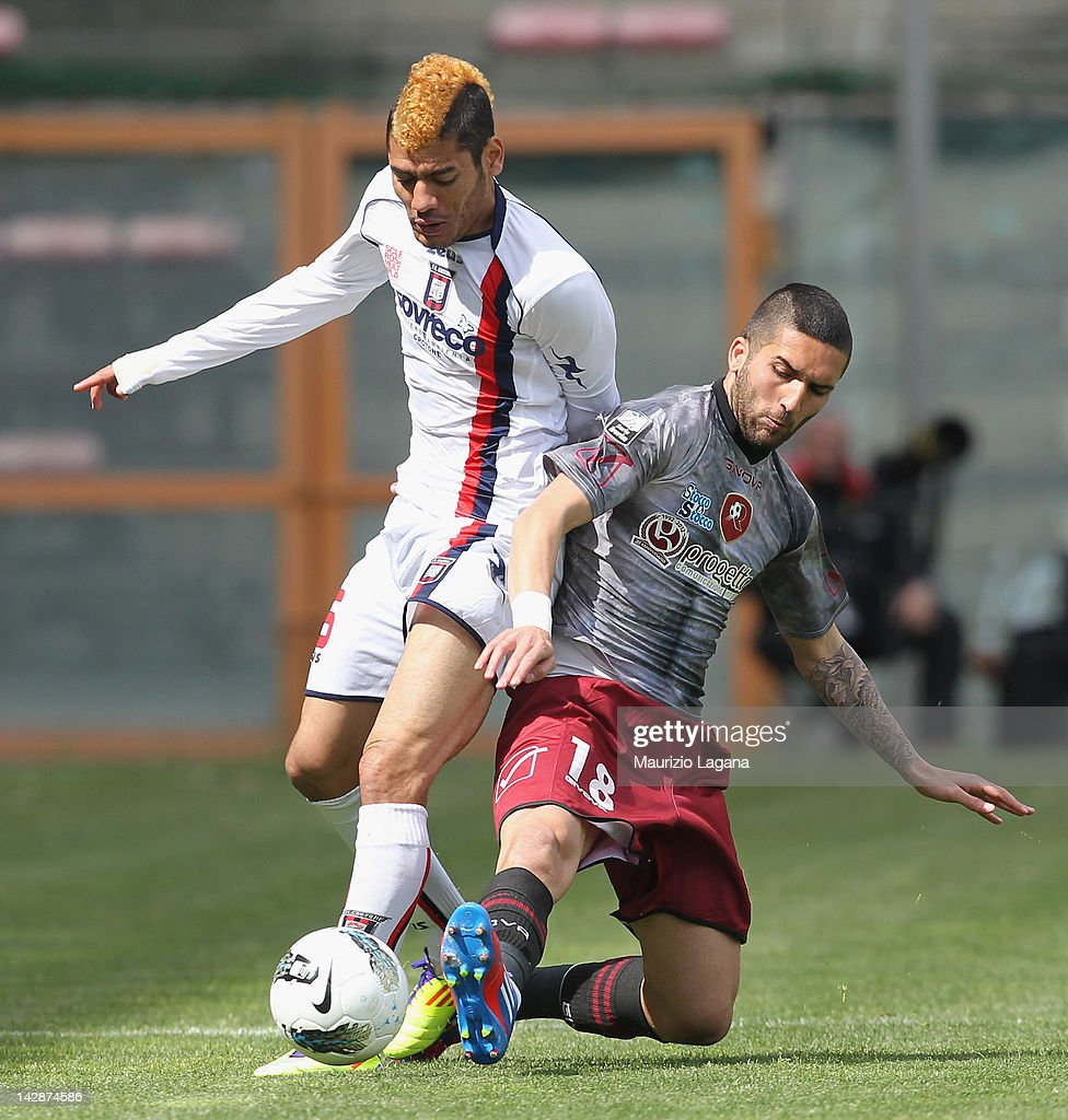 Giuseppe Rizzo of Reggina competes for the ball with Denilson Gabionetta of Crotone during the Serie B match between Reggina Calcio and FC Crotone at...