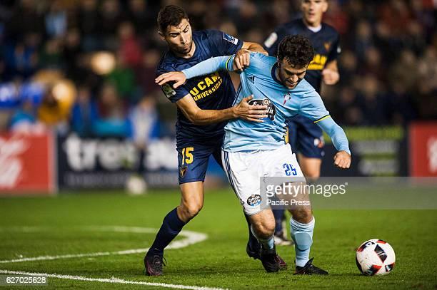 Giuseppe Rossi and Jairo Morillas during the match between UCAM CF against RC Celta de Vigo round of 16 of Cup in Condomina stadium The Celta of Vigo...
