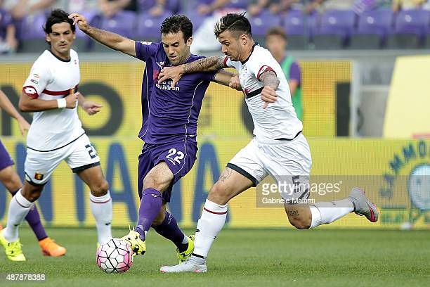 Giuseppe Rossi of ACF Fiorentina battles for the ball with Armando Izzo of Genoa CFC during the Serie A match between ACF Fiorentina and Genoa CFC at...