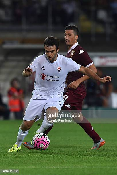 Giuseppe Rossi of ACF Fiorentina in action against Giuseppe Vives of Torino FC during the Serie A match between Torino FC and ACF Fiorentina at...