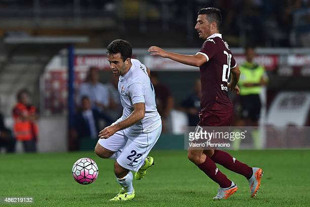 Giuseppe Rossi of ACF Fiorentina is challenged by Giuseppe Vives of Torino FC during the Serie A match between Torino FC and ACF Fiorentina at Stadio...